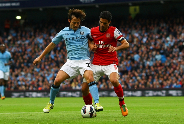 David Silva of Manchester City and Mikel Arteta of Arsenal