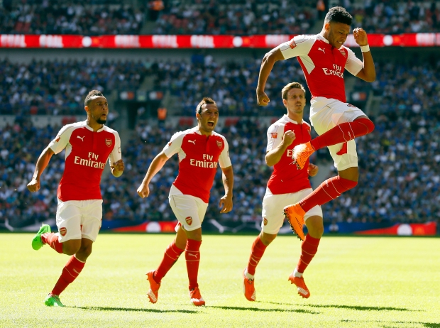 Arsenal's Alex Oxlade-Chamberlain, right, celebrates after he scores a goal  during the English Community Shield soccer match between Arsenal and Chelsea at Wembley Stadium in London, Sunday, Aug. 2, 2015. (AP Photo/Kirsty Wigglesworth)